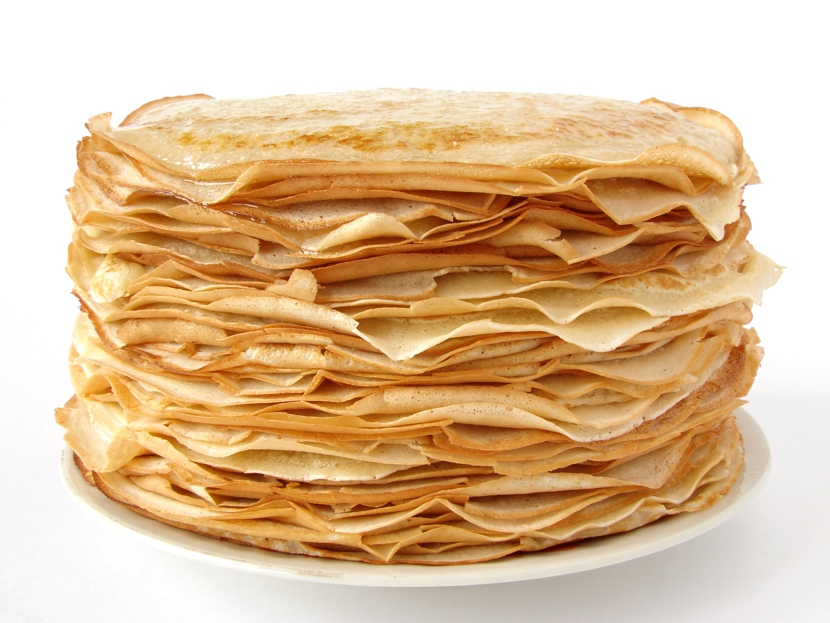 A stack of crepe pancakes on a white plate